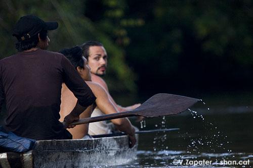 David and Waorani people paddling on Yasuni river